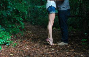 Woman on tiptoes next to man